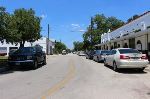 Cars are parked along Michigan Street, looking north. Photo by Page Graham.