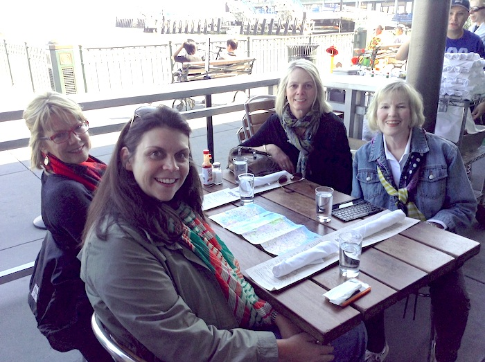 Docents Sandy Ragan, Gill Pilgrim and my conference co-presenter Teri Evans-Palmer enjoying some oysters on the water in San Francisco. Courtesy photo.
