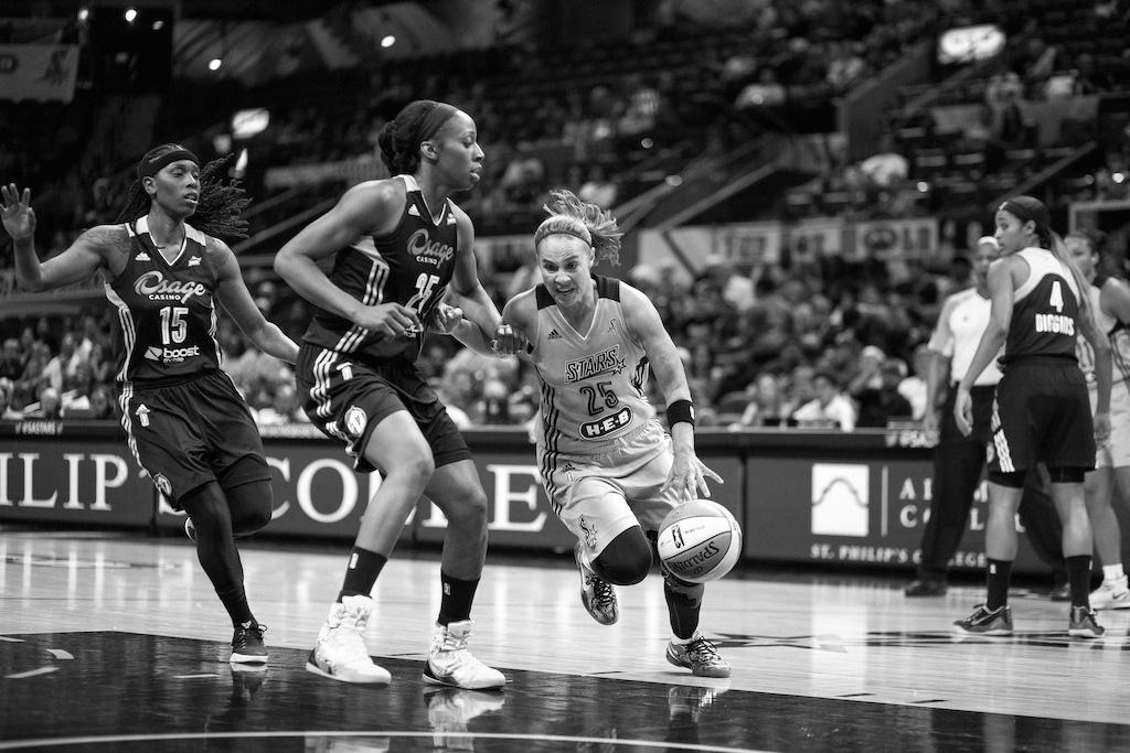 San Antonio Star Becky Hammon speeds past a defender. Photo by Scott Ball.