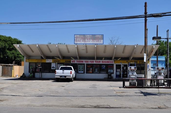 A neighborhood convenience store on the Westside, right across the street from the San Juan development. Photo by Iris Dimmick.