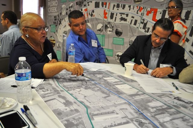 Michael Guarino of Ford Powell & Carson Architects (right) takes notes during the San Pedro Park public workshop. Photo by Iris Dimmick.