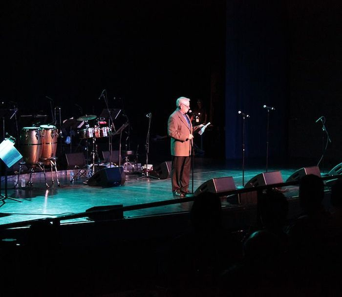 Executive Director of Arts San Antonio John Toohey welcomes the crowd to the Aztec. Photo by Melanie Robinson.