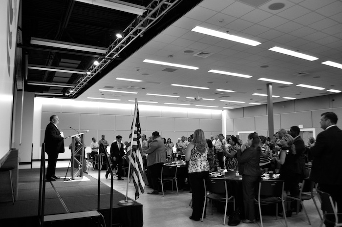 More than 120 people give retiring Port San Antonio President and CEO Bruce Miller a standing ovation at the State of the Port 2014 luncehon. Photo by Iris Dimmick.