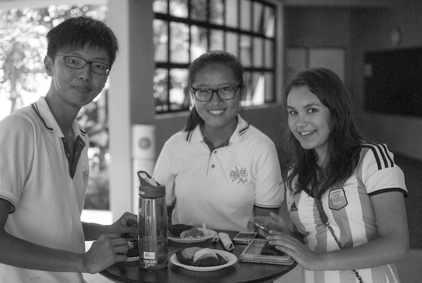 Singaporean students and Jocelyn Hernandez in Dunman High School, a top-ranking institution. Photo by Aaron Eisenberg.