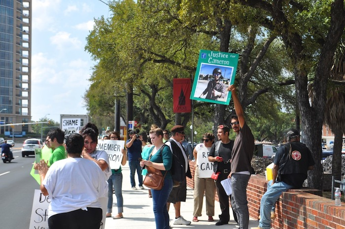 Protesters march and chant  in front of UIW on Broadway Street, calling for remembrance and justice for Cameron Redus. Photo by Iris Dimmick.