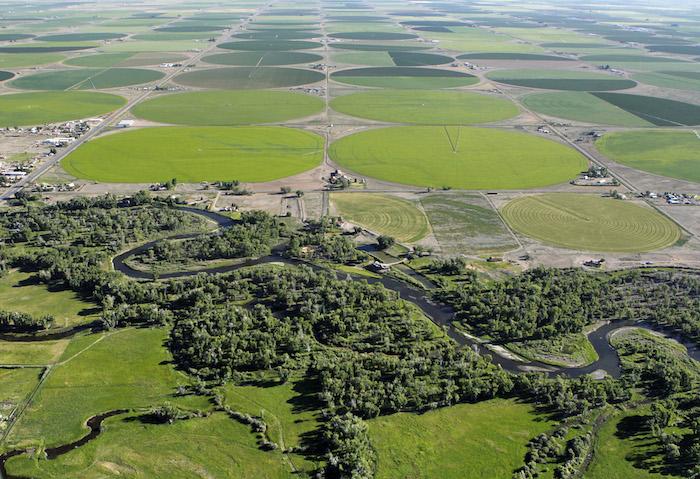 DEL NORTE, CO - Aerials views over the Del Norte and Monte Vista, Colorado area with the Rio Grande River and the center-pivot agricultural fields. JUNE 28, 2014. CREDIT: Erich Schlegel/Disappearing Rio Grande Expedition