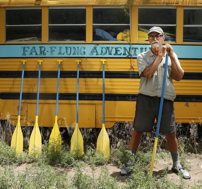 PILAR, NM - River guide and advocate, Steve Harris stands next to a bus he used to shuttle clients with on the Rio Grande.near Pilar, New Mexico. JULY 17, 2014. Harris founded Far Flung Adventures in the 1970's. CREDIT: Erich Schlegel/Disappearing Rio Grande Expedition