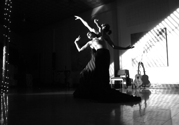 "Stephan Gaeth and Tamara Adira performing the signature piece to ""Angel of Gravity."" Photo © Nicole Marie Moore."