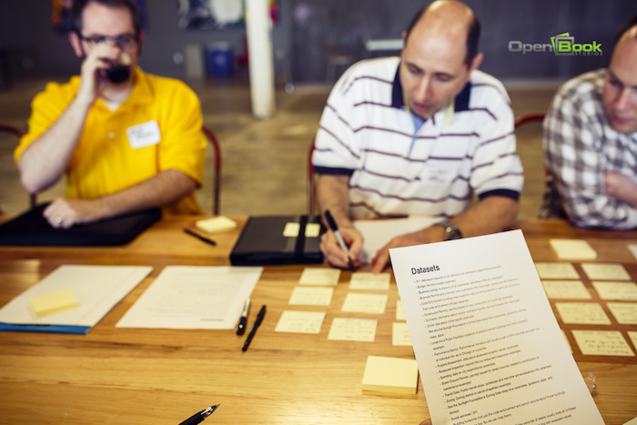 Participants take notes during the CodeAcross input meeting at Rackspace. Photo by Kara Gomez/Open Book Studios.