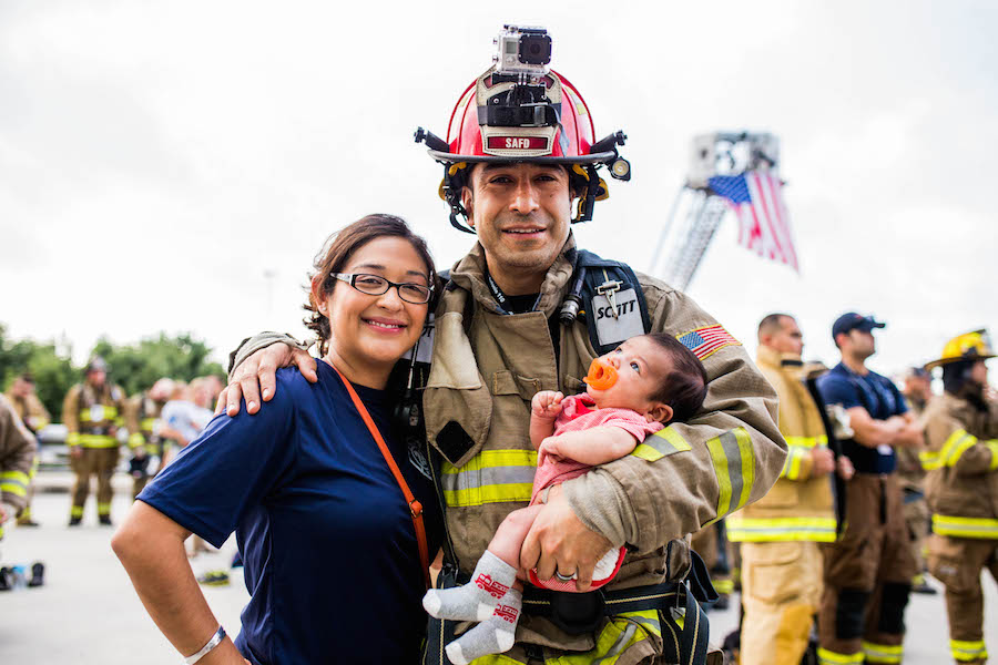 The Lopez family honors those that lost their lives on September 11 during the second annual San Antonio 110 9/11 Memorial Climb. Photo by Scott Ball.