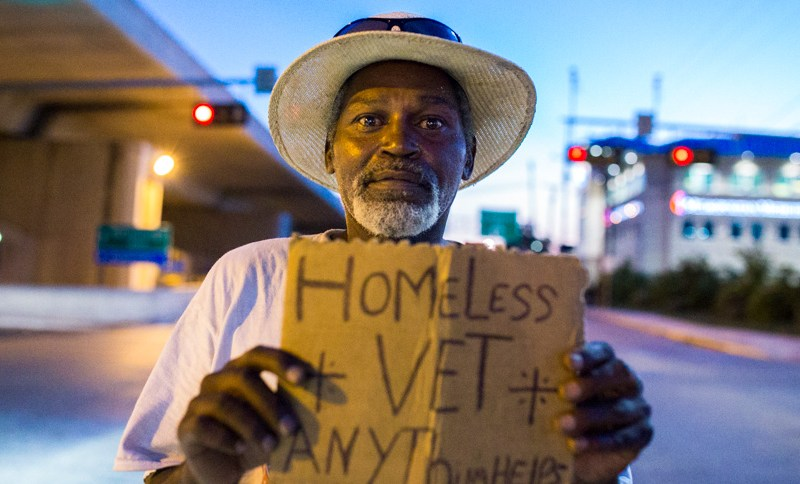 "Earl, an Armed Forces veteran has been panhandling for more than 15 years. "" I can't get a job, the only jobs available are manual labor. I'm too old to work manual labor, I just can't function in this society."" he said. Photo by Scott Ball."
