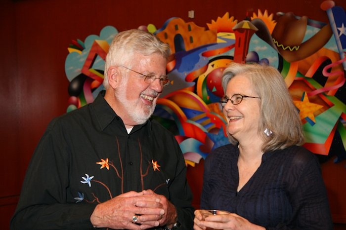 John Donahue laughs with Nancy Mills at his retirement party at Trinity University. Courtesy photo.