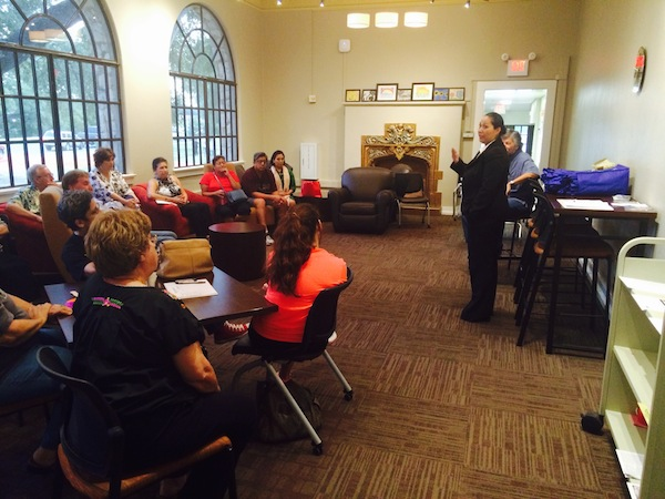 Mari Aguirre-Rodriguez meets with the Woodlawn Lake Community Association at the Woodlawn Wi Fi Room. Courtesy photo.