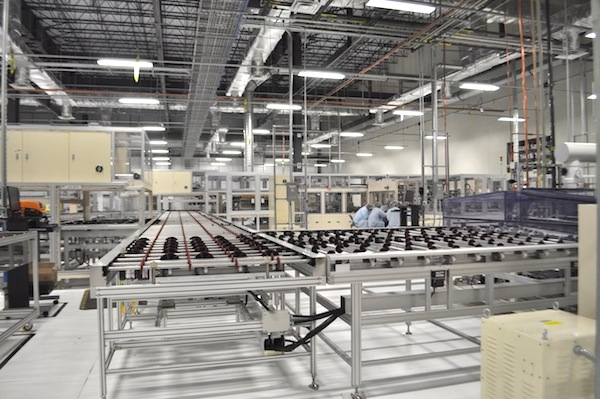 Employees take and afternoon break from the panel assembly line at Mission Solar Energy manufacturing plant. Photo by Iris Dimmick.