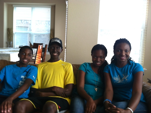 The Osonma family in their home. From left to right: Jason Osonma, Robert Osonma, Lisa Osonma, and Cici Osonma. Photo by Samuel Jensen.