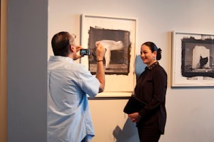 Michael Mehl, founder of Fotoseptiembre USA, snaps a photo of Patricia Ruiz-Healy, Director of Ruiz-Healy Art. Courtesy photo.
