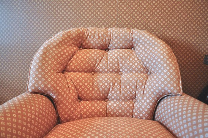 Matching upholstery and wallpaper in the Red Berry Mansion. Photo by Iris Dimmick.