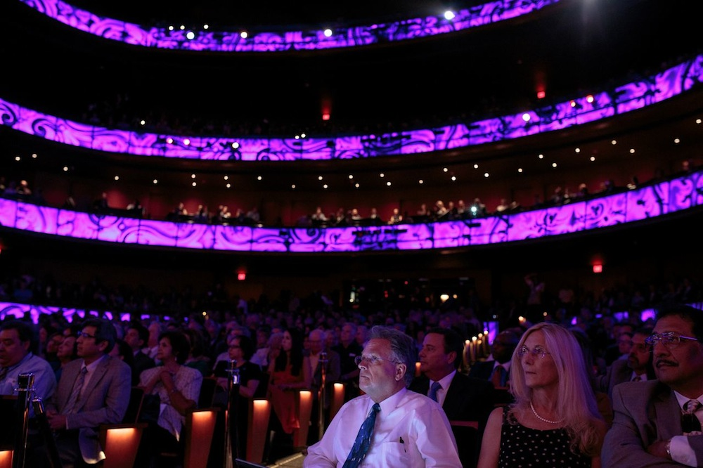 Illuminated panels inside the packed house during the Tobin Center's opening ceremony. Photo by Scott Ball.