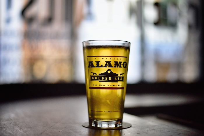 A fristy glass of Alamo Beer await consumption at the Esquire Tavern.