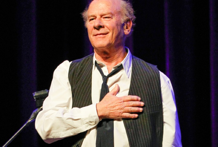 Art Garfunkel places his hand on his heart in a recent photo published in Rolling Stone magazine. Photo by Terry Wyatt.