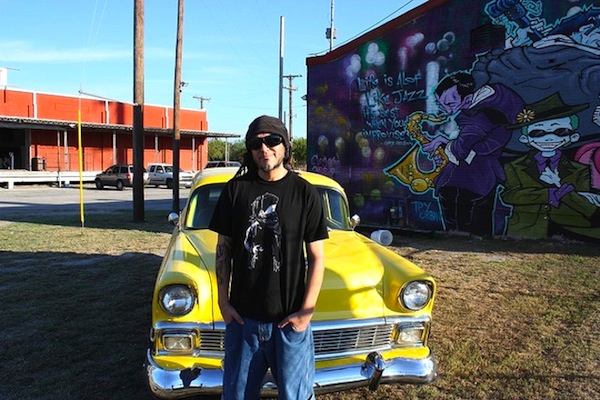 Nik Soupe poses for a photo next to his jazz inspired mural that he completed in April of this year. Photo by Kay Richter.
