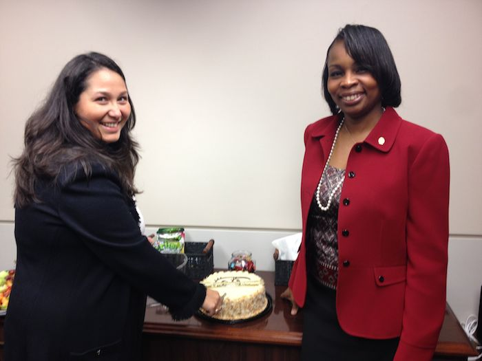 Outgoing District 7 Councilmember Mari Aguirre-Rodriguez cuts her farewell (but not goodbye) cake with Mayor Ivy Taylor. Photo by Robert Rivard.