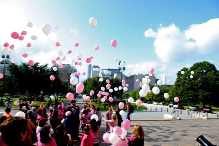 Pink and white ballons are released at the State Capitol in Austin at the Texas Commission for Women rally on Oct. 1 to recognize National Breast Cancer Awareness Month. Courtesy photo.