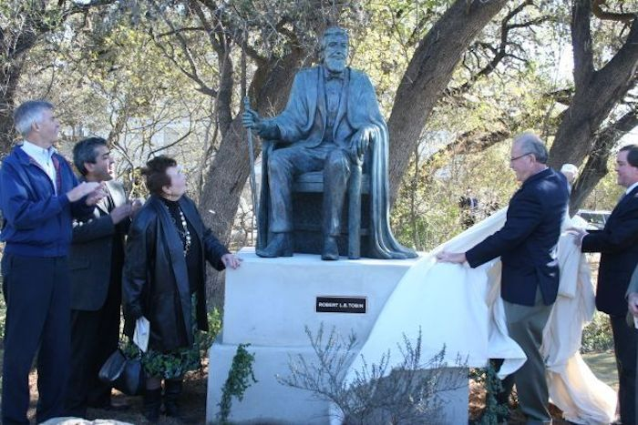Then Mayor Phil Hardberger (right), former Mayor Howard Peak (far lefl), and Mayor Emeritus Lila Cockrell (left, center) unveil the Robert L.B. Tobin statue at the Salado Creek Greenway trailhead in 2008 with Bruce Bugg Jr., chairman and trustee of the Tobin Endowment (far right).