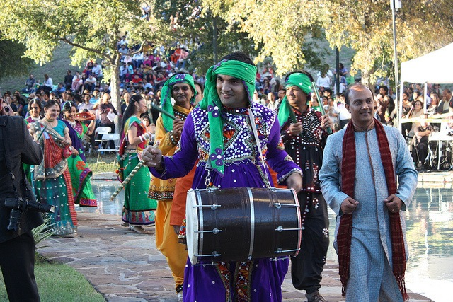 Men and women from different regions of India dance and drum during the Parade of States at the 2013 Diwali San Antonio festival. Photo by Kay Richter.