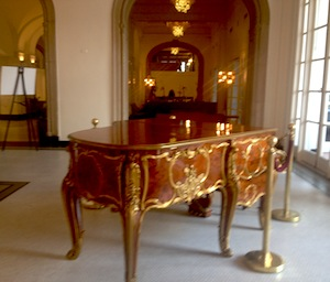A gilded grand piano in the St. Anthony Hotel lobby. Photo by Robert Rivard.