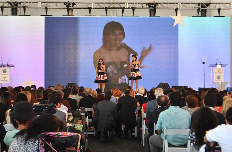 Singers Leamsi and Cassandra perform during the grand opening ceremony of CRIT USA. Photo by Iris Dimmick.
