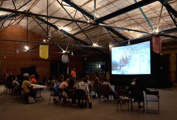 Viewers take their seats in the Cleary Zimmermann warehouse. A food truck was on hand for refreshments. Photo by Gretchen Greer.
