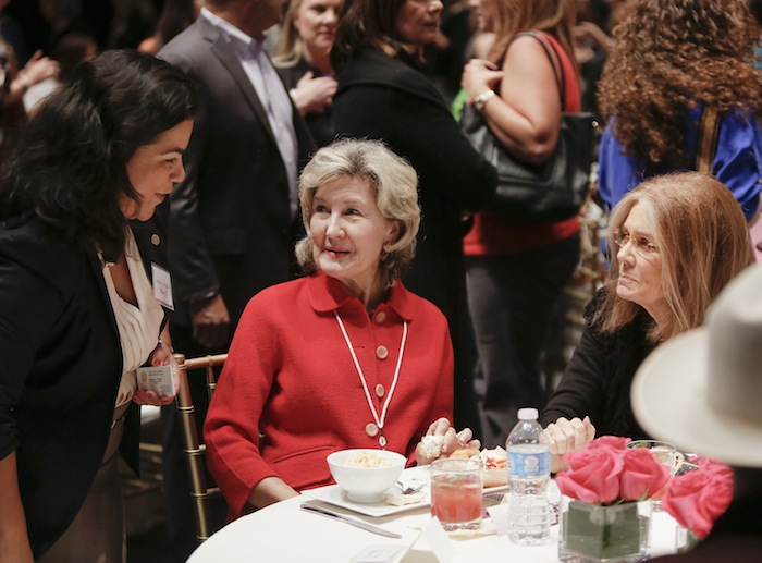 Former Senator Kay Bailey Hutchison, center, and feminist activist Gloria Steinem, right, talk with District 3 Councilmember Rebecca Viagran during the Women In The World Texas Forum. Photo by Josh Huskin/DA Media for Women in the World.