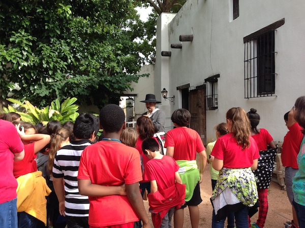 Students talk with a living history interpreter at the Spanish Governor's Palace during a Heritage Education Tour. Courtesy photo.