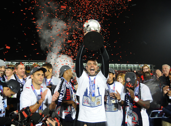 Members of the NASL Champion San Antonio Scorpions hoist the Soccer Bowl Trophy following their 2-1 victory over the Fort Lauderdale Strikers. Photo by Kristian Jaime.