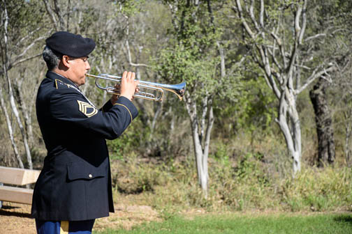 """A member of the 323rd Army Band, """"Fort Sam's Own,"""" plays Taps during the wreath-laying ceremony. Photo by Annette Crawford."""