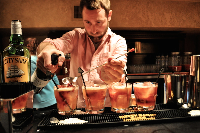 Benji Pocta of Chino Chinatown in Dallas mixes four Cutty Side Scuttles at the opening party for the 2014 San Antonio Cocktail Conference. Photo by Iris Dimmick.