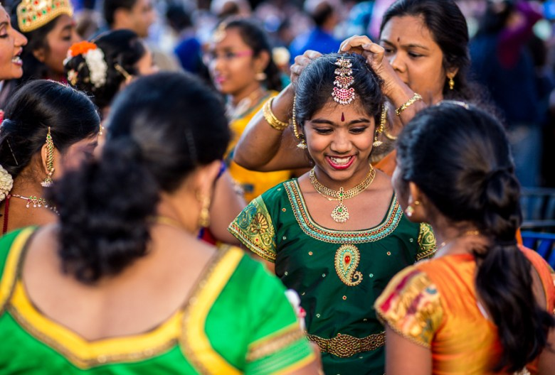 A girl receives last minute styling from her mother at the 6th annual Diwali San Antonio.  Photo by Scott Ball.