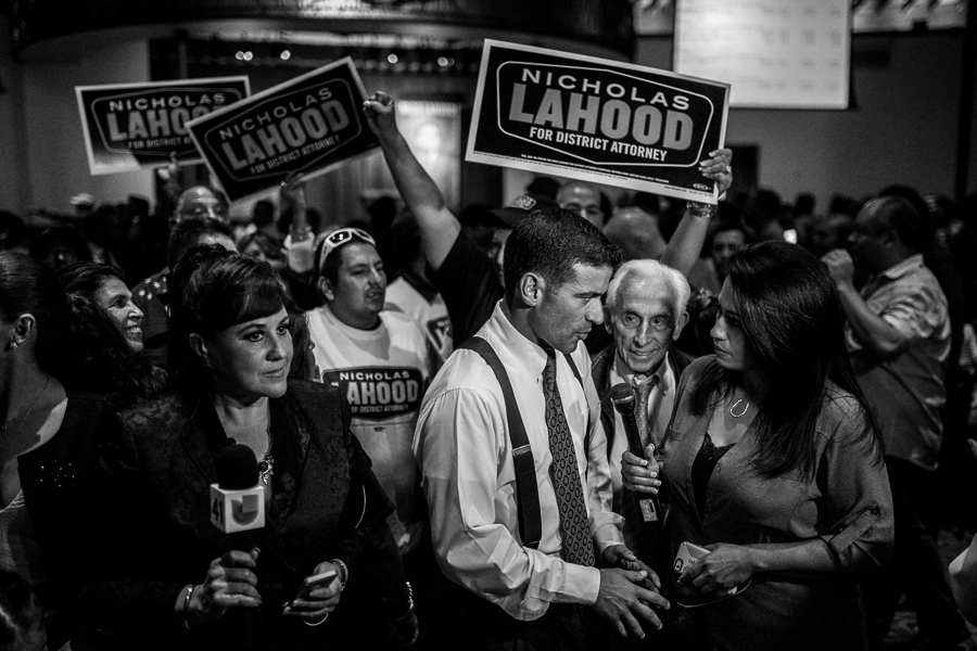 """Nicholas """"Nico"""" LaHood speaks with a reporter at his election party. Photo by Scott Ball."""