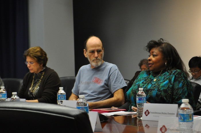 SAGE Executive Director Jackie Gorman (right) and fellow task force member Rod Radle (center) discuss the possibility of setting up a City bond for affordable housing. Photo by Iris Dimmick.