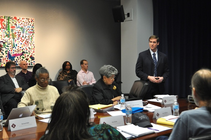 Interim Assistant Director of Planning and Community Development Michael Taylor (right) presents policy data to the Mayor's Task Force on Preserving Dynamic and Diverse Neighborhoods including former Councilmember María Berriozába (center) and Nettie Hinton (left). Photo by Iris Dimmick.