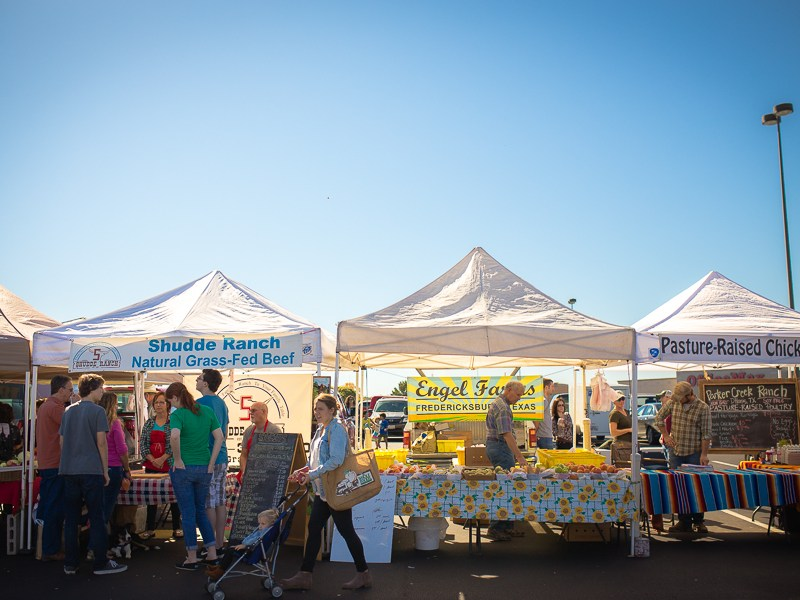 Vendors line the parking lot of the Quarry Farmers & Ranchers Market. Photo by Scott Ball.