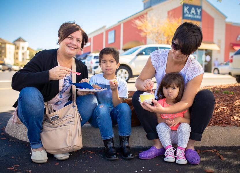 The Veglio family enjoys dessert at the Quarry Farmers & Ranchers Market.