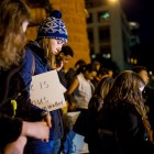 Protestors bow their heads during a word of prayer at the SATX4Ferguson protest. Photo by Scott Ball.