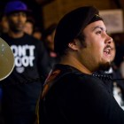 """Felix"" from the activist group The Brown Berets speaks to the crowd at the SATX4Ferguson protest. Photo by Scott Ball."