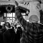 A protestor holds up his hands while chanting at the SATX4Ferguson protest. Photo by Scott Ball.