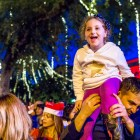 A child gets a better view of Santa during the H-E-B Tree Lighting Ceremony. Photo by Scott Ball.