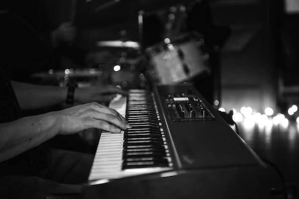 Chris Villanueva on piano with Midtown Jazz Sound at SoHo Wine and Martini Bar. Photo by Jennifer Lyde of Parish Photography.