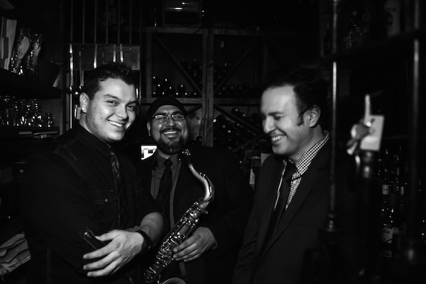 Midtown Jazz Sound pauses for a laugh at SoHo Wine and Martini Bar. Photo by Jennifer Lyde of Parish Photography.