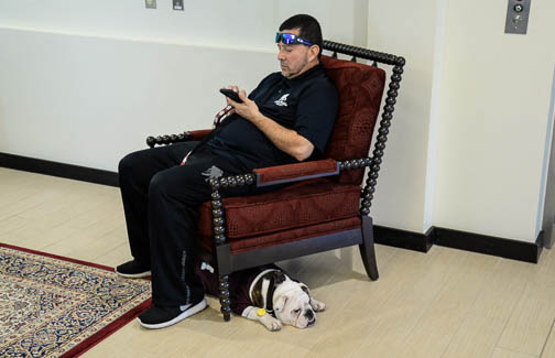 A guest and his dog take a break during the self-guided tour of the Patriots' Casa. Photo by Annette Crawford.